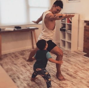 Travis working out with his son