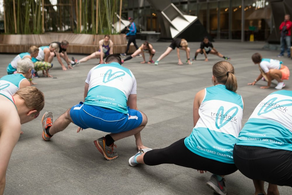 Eager participants getting limber with Grace before Trekstock's Conquer the Tower