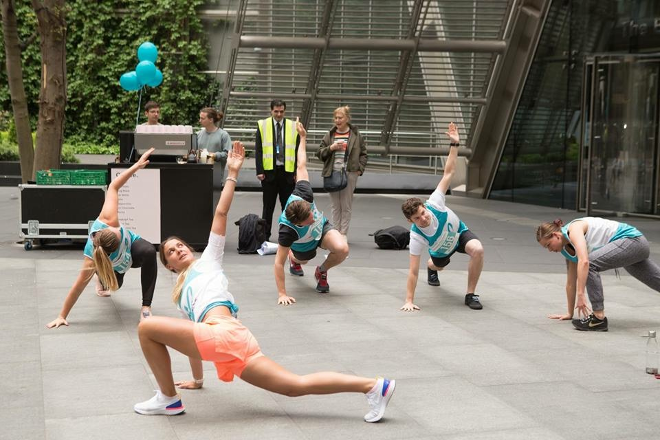 Competitors looking at the 35 floors of the Conquer the Tower during their warm up with Grace for Trekstock.