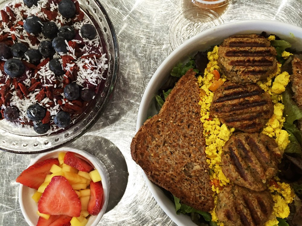 a light breakfast with friends. a customized açai bowl with goji berries, coconut & blue berries! My order of tofu scramble with falafel. I love how their scramble is on a bed of greens. Soooo healthy and super filling.