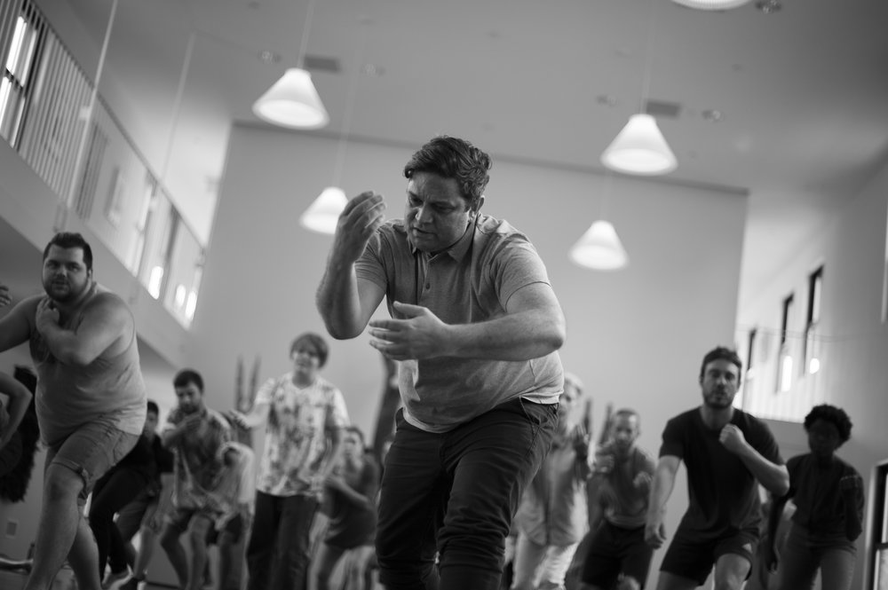 Wesley Enoch performing aboriginal dance moves
