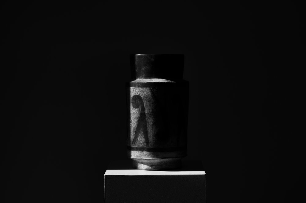 Vase in shadows.