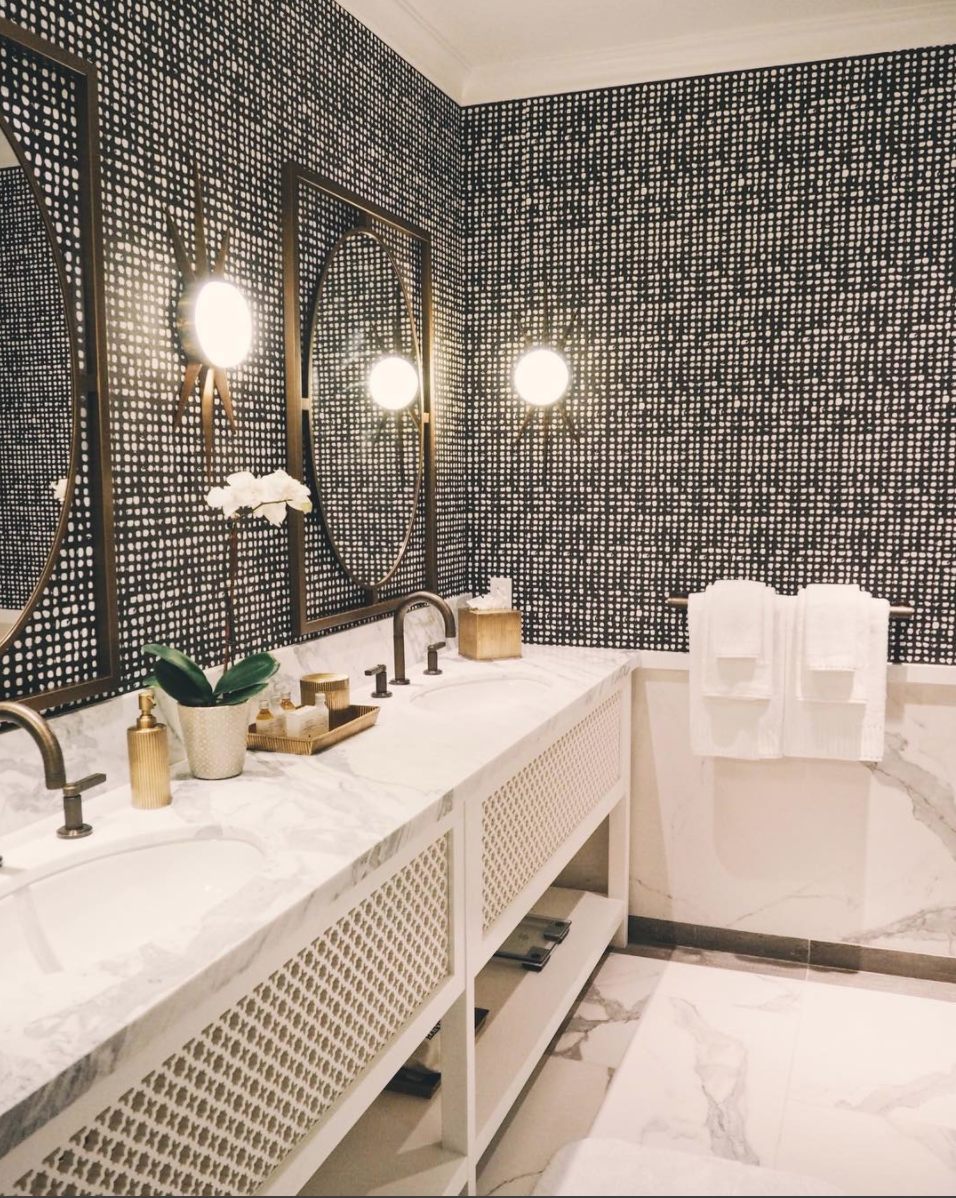 Gorgeous Bathroom displaying the Moorish Design combining Gold, White & Black and Spanish Quatrefoil Shapes with Moroccan oil rubbed brass fixtures | Image: Hotel Californian