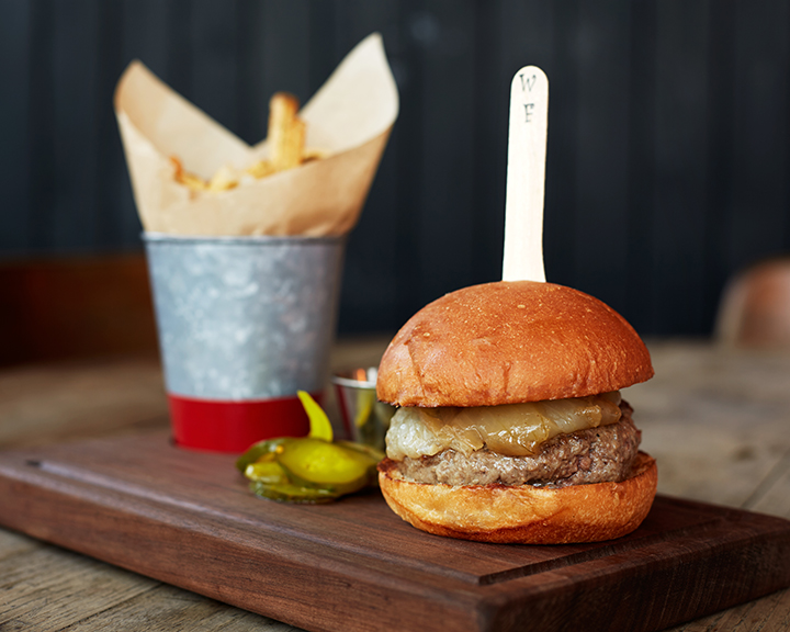 A fan favorite: The Cast Iron Bar Burger. With butter baked onions, tomato relish and hand-cut fries.