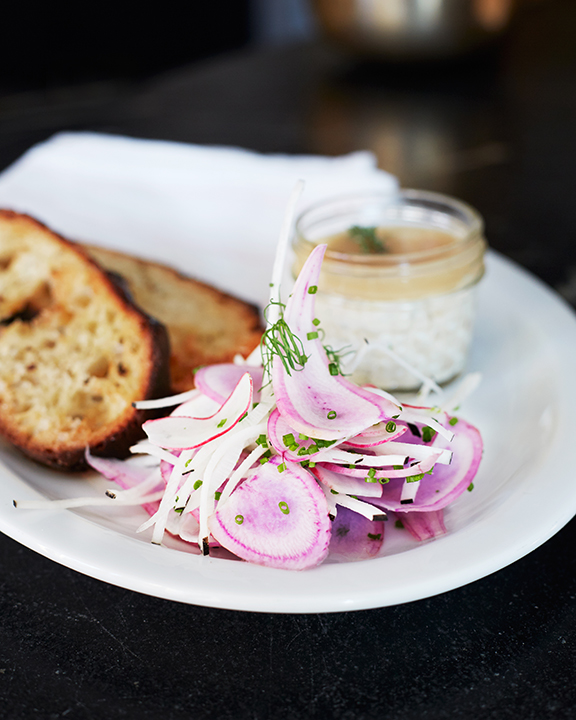 Our Smoked Salmon Mousse with pickled onions, crème fraiche, mustard seeds and grilled bread.
