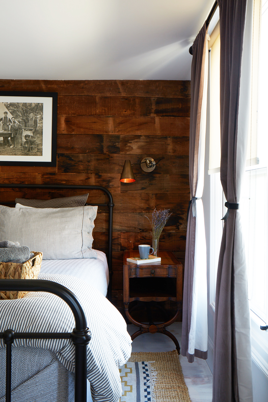 The Abigail Suite - bedside table with book and coffee