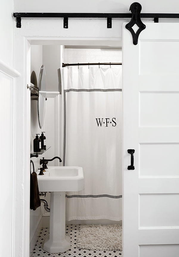 The Pennington Suite - sliding barn door into bathroom with full tub and shower