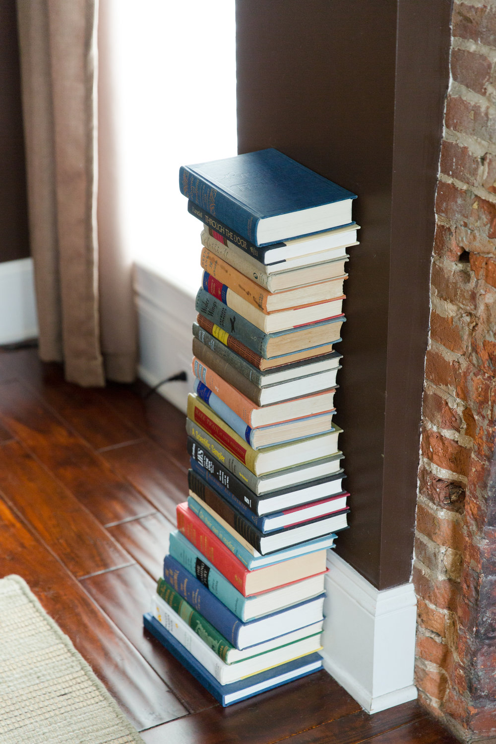 """""""The Mercer"""" in the Merchant House - stack of books"""