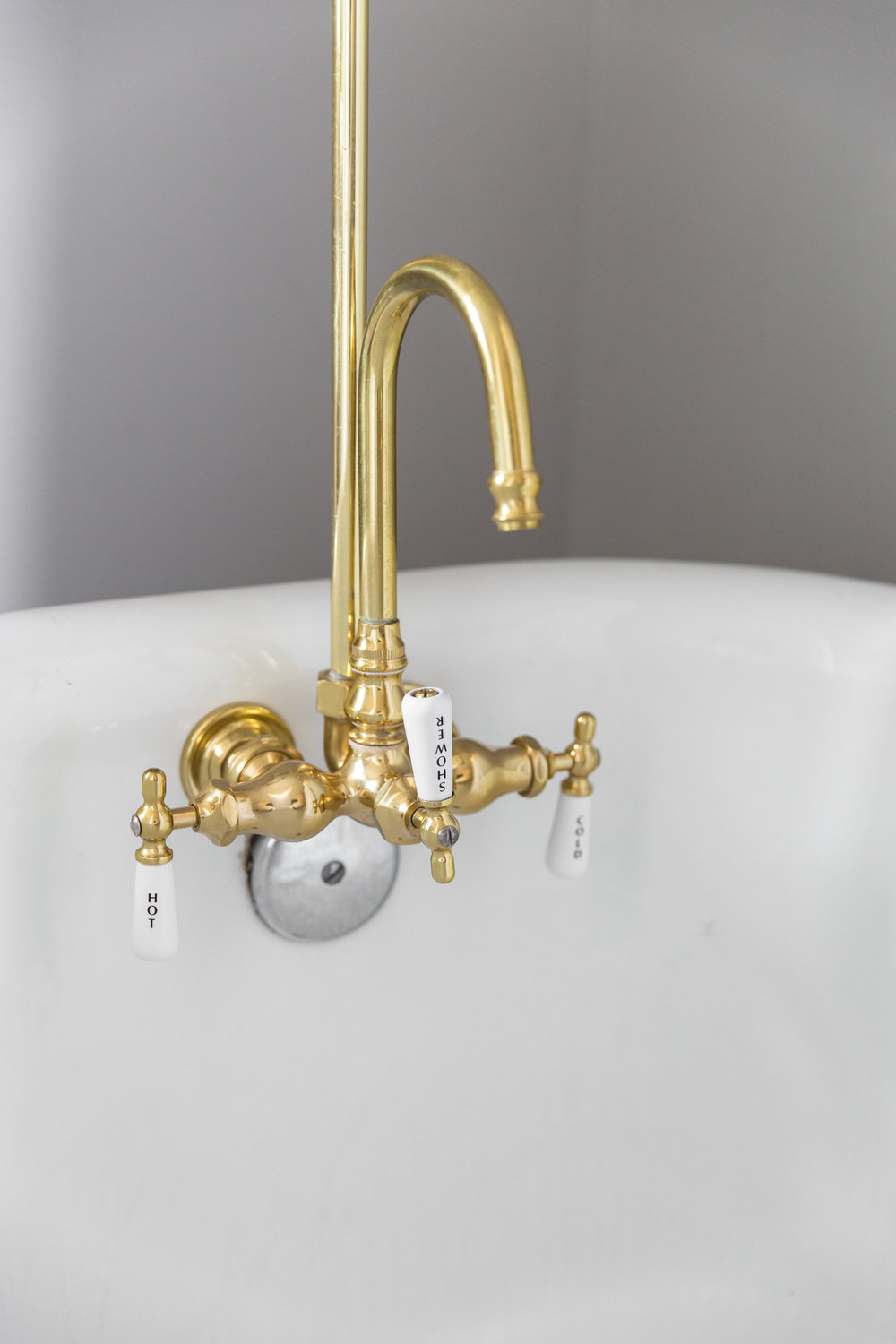 The Lee Wendell Suite - brass faucet and handles in tub