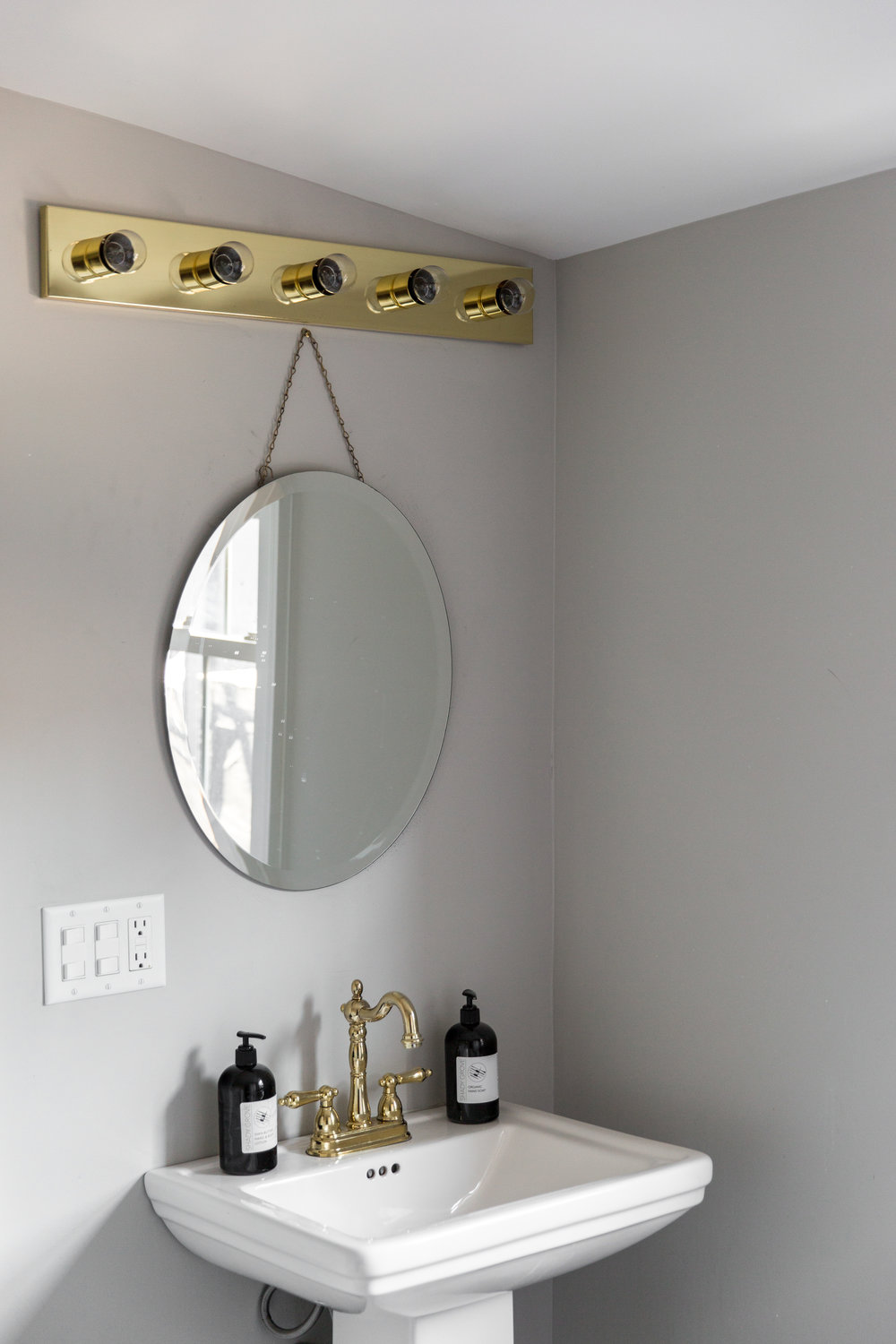 The Lee Wendell Suite - bathroom sink and mirror