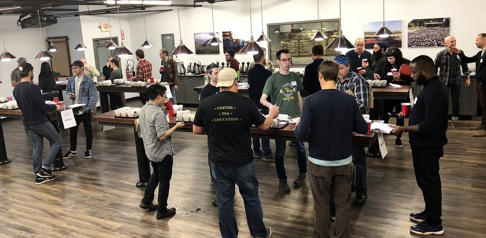 A photo from one of Royal New York's regular Micro Lot Cupping events. These events can involve 3 to 4 cupping flights and 30+ attendees. It takes multiple people to make this event happen smoothly, but it gets easier every time and is always a success!