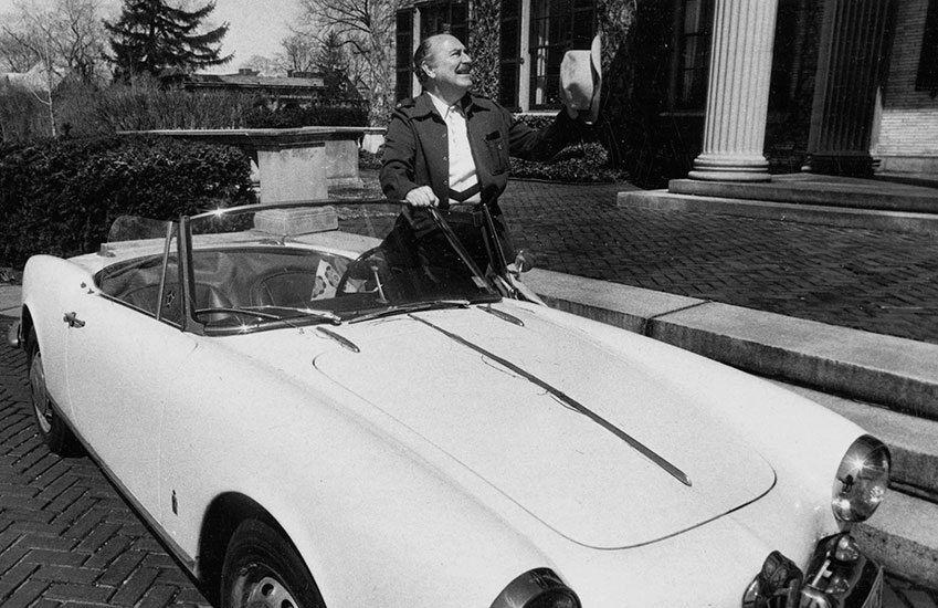 James Card in his convertible outside of the  George Eastman Museum