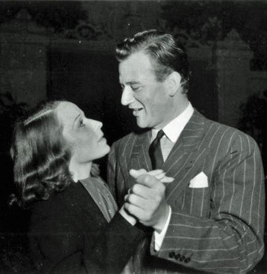 Louise Brooks and John Wayne at the wrap party for Overland Stage Raiders (1938) (more on John Wayne later...)