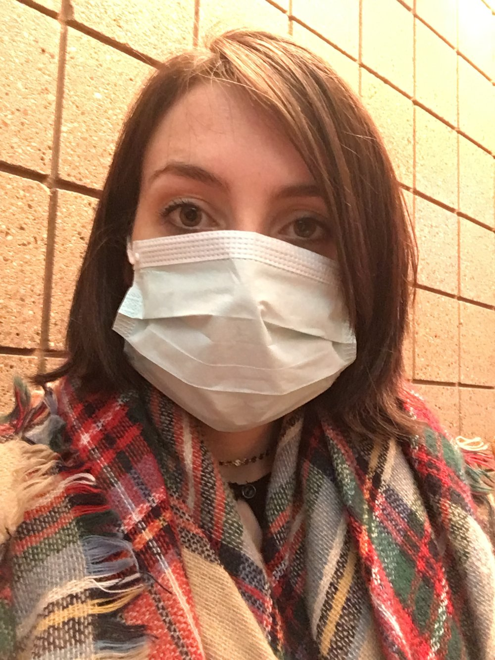 They made me wear one of these things in case I had the flu- and you guys thought I couldn't get any cuter-