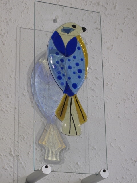 Blue Bird- £150.00 (ex brackets)  -   ENQUIRE NOW     15cm x 37cm-  fused glass on clear glass pane   Each piece comes with it's own custom made wooden free standing base  The wall mounting brackets can be supplied for an additional cost
