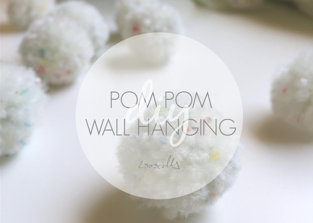 DIY pom pom wall hanging by isoscella