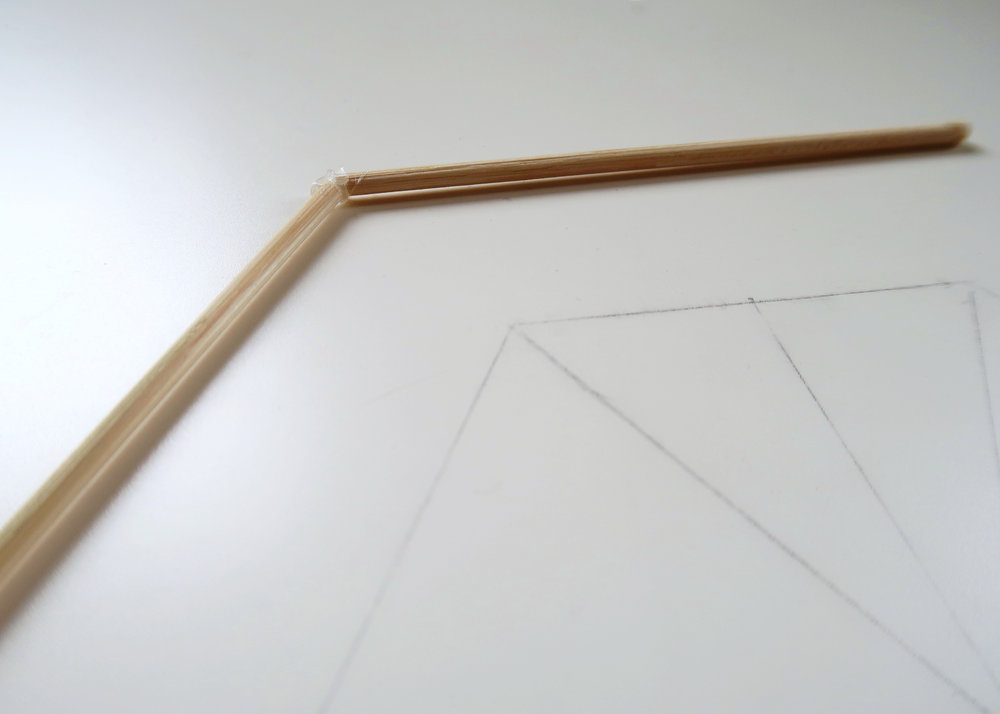 4. - Next you'll need to make a larger hexagonal shape using six 10cm skewers and a miniature hexagon using the 2.5cm skewers. The hexagon we drew out is helpful here to guide the angle you glue the pieces together at.