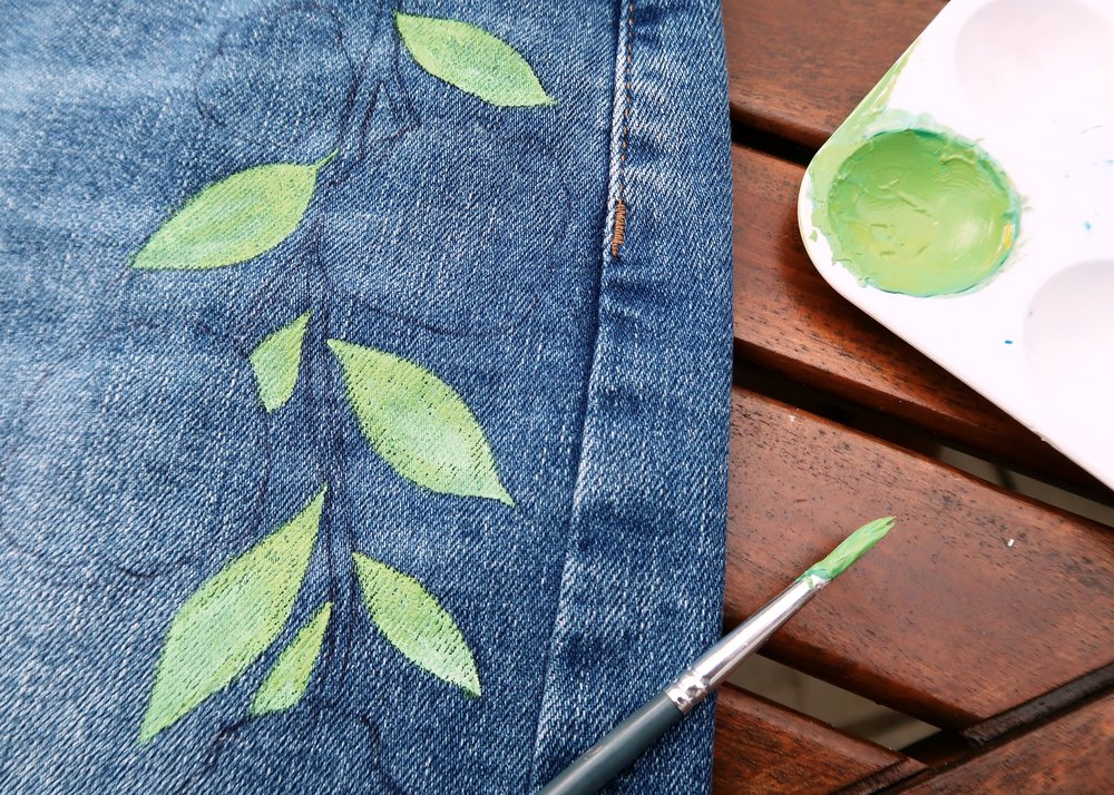 3. - Using the fabric paints, mix up various shades of green and using the lightest colours first start painting the leaves. To create some depth, paint one end of the leaves in a brighter colour than the other.
