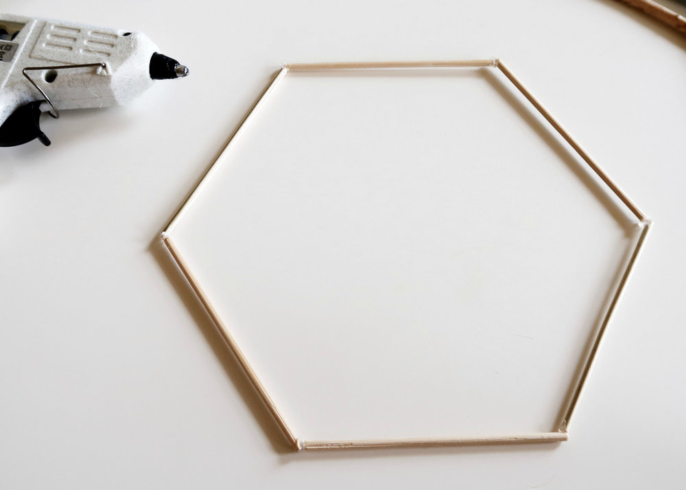 6. - You'll then need to use the hot glue gun to stick these three structures together to create a hexagon. Again, you want to stick the ends together at a 120 degree angle. Use as much glue as you need to make sure this is nice and study.