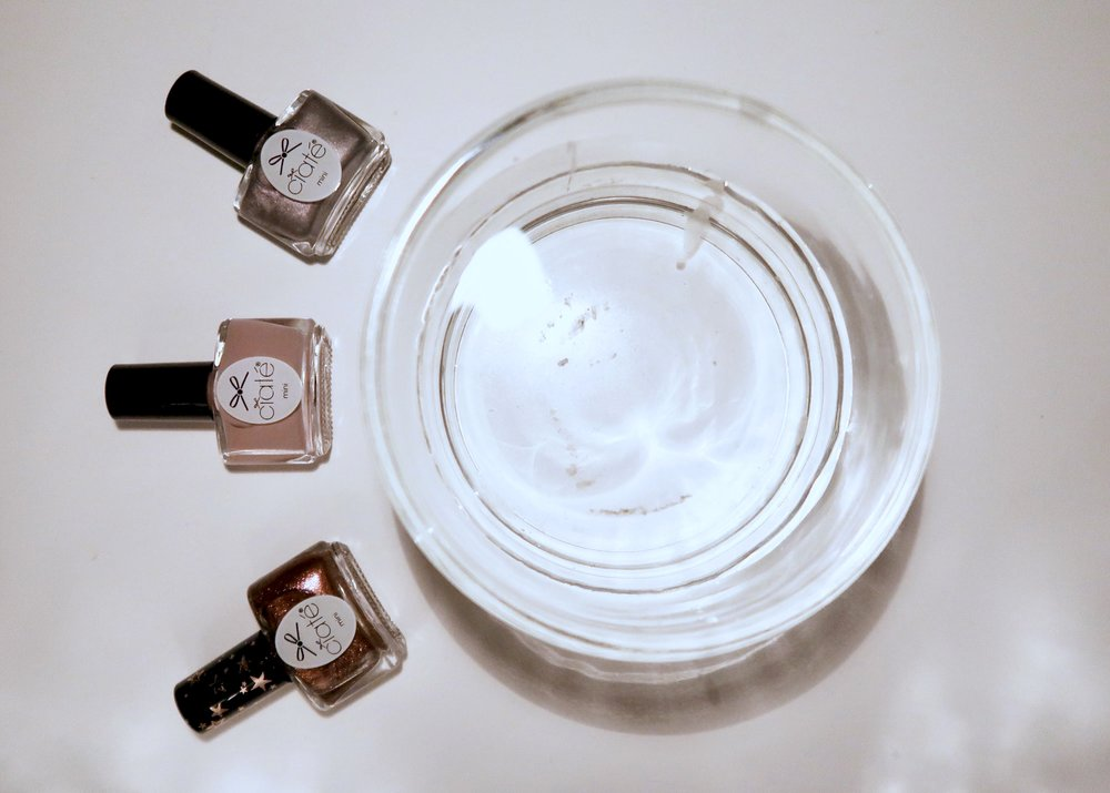 4. - Next, fill a bowl or plastic container (that you don't mind getting messy) with water and choose some nail varnishes. In the end I chose to just use a grey nail varnish but I did some experimenting with these Ciate nail varnishes.