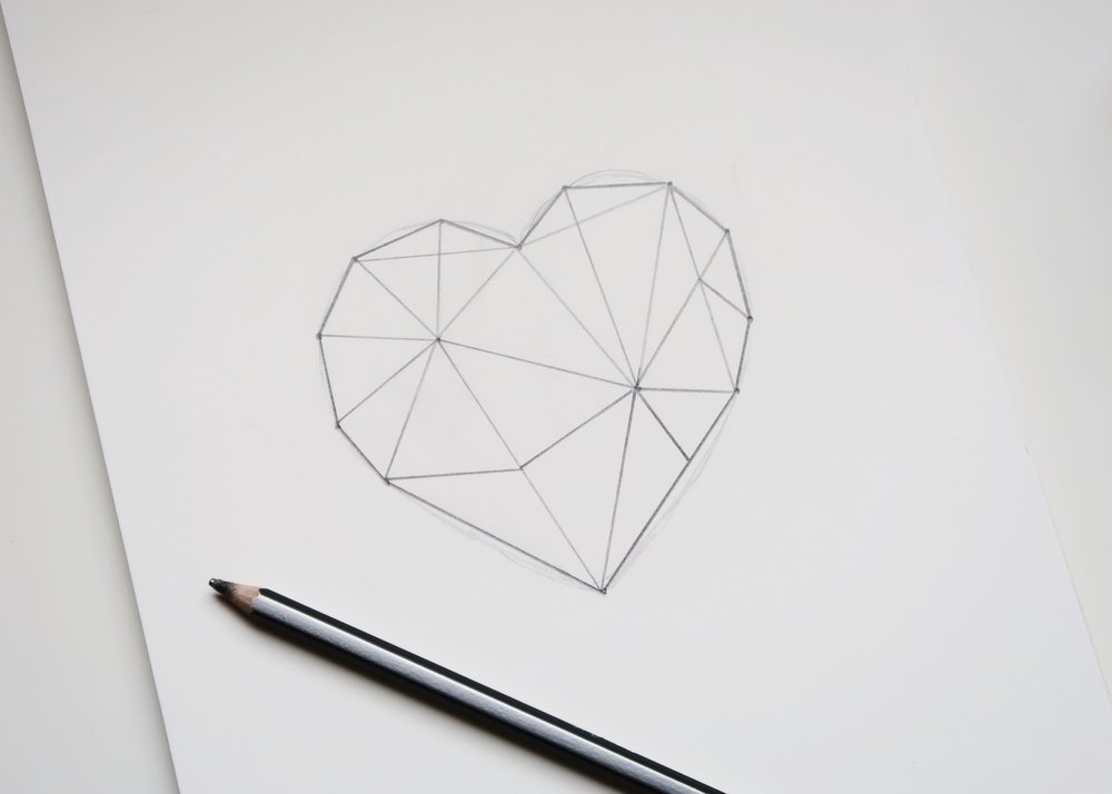 2. - Next, join these two centre points with a straight line. Continue drawing straight lines from each of these centre points to the points around the edge of the heart until you're happy with your design. Thicken these lines until they are approximately 4mm wide.
