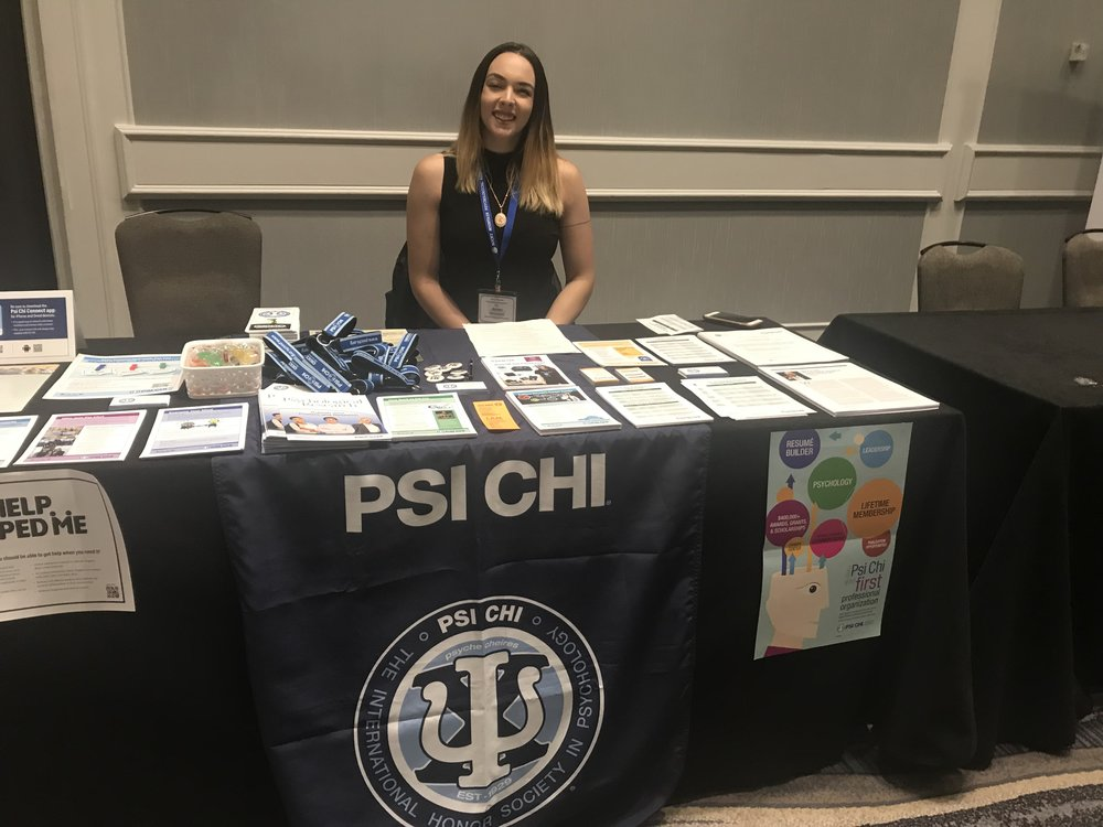Psi Chi exhibition table with Regional Steering committee student member Keren Bakke.jpg