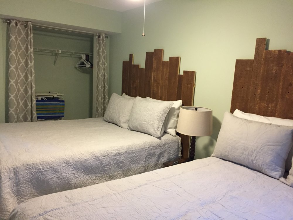 Guest bedroom w closet and beach chairs.JPG