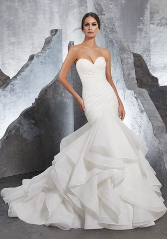 Morilee 5604  combines the figure-flattering effect of ruching with trendy and dramatic horsehair ruffles!
