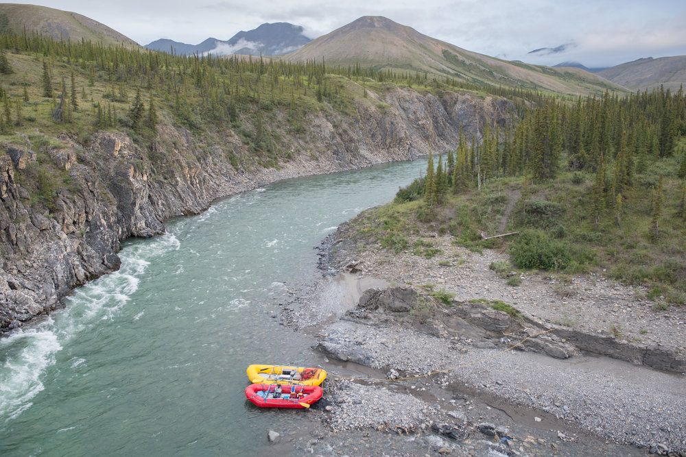 A rafting party alight at Sheep Creek