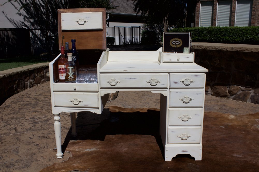 Vintage 1950s desk makes a great cigar bar- $100 rent/$250 purchase