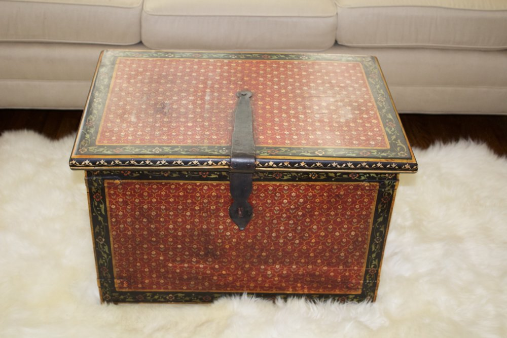 Painted trunk makes a cute coffee table $40 rent $150 purchase
