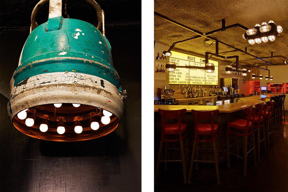 Vue du bar avec luminaires industriel suspendus au-dessus des différentes zones. Menu fait d'un tableau d'affichage jaune avec lettres vintages. Luminaire sur mesure fait d'une ancienne bouée marine