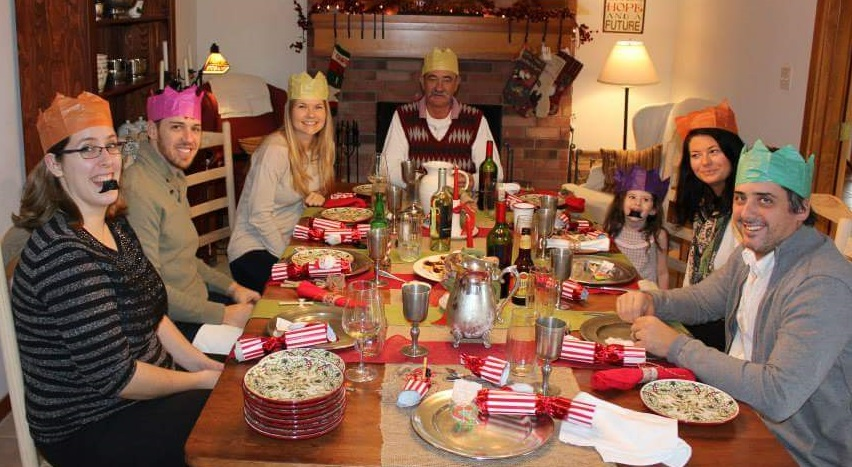 See the crackers on the table, and everyone's crowns? And the mustache whistles? And there's mince pies in the center of the table.
