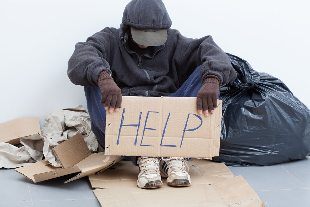 "Homeless person with ""HELP' sign"