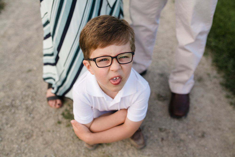 Boy sticking out tongue - Rochester MI Family photographer