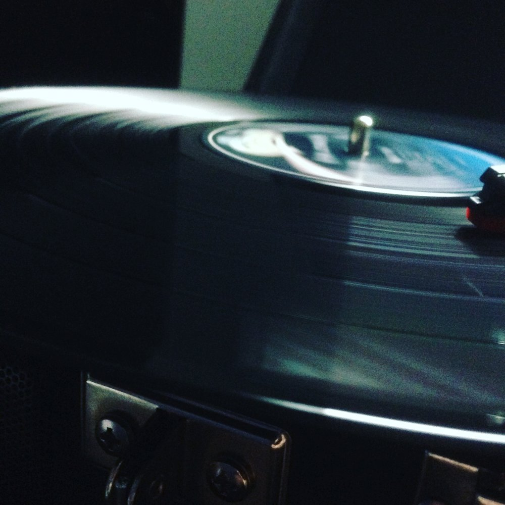 A Vinyl Record spinning on a turntable. Photograph by James Hardiment.