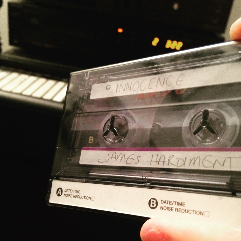 "Pictured above is a Compact Cassette! Click on the image if you want to see our latest single from James Hardiment called ""Innocence"" the song is about childhood in the UK and features old tech such as the cassette!"