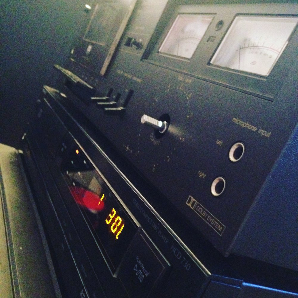 An old cassette deck and CD player pictured above. Photograph by James Hardiment.