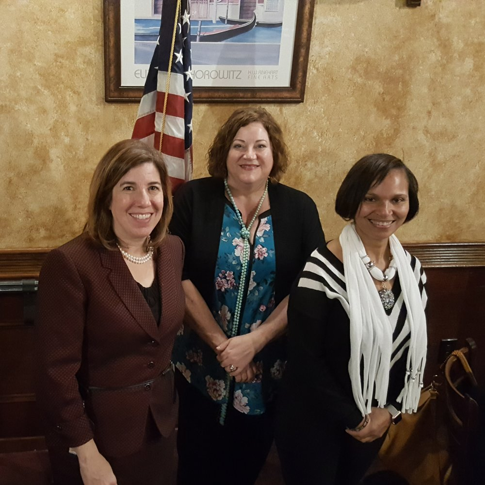 """At their November meeting, Central Montgomery County Business and Professional Women President, Becky Shoulberg, (center) invited Secretary of Transportation, Leslie S. Richards (left) to interpret BPW PA state theme, """" Bridge to the Future"""". Vice President Sue Soriano (right) echoed Leslie's experience working in a field dominated by men and the importance of showing young women the changing face in the workplace, especially in the STEM industries."""