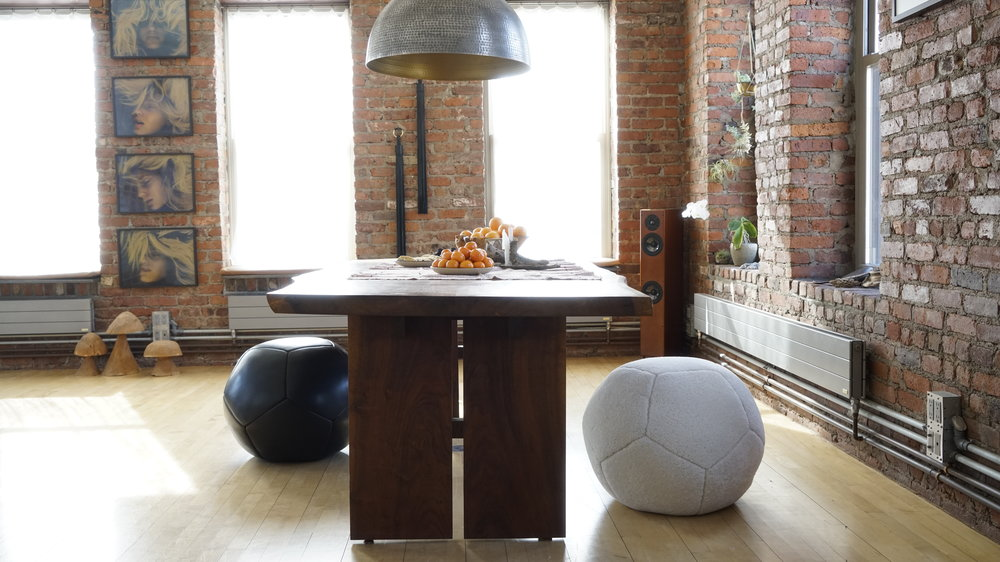 Urban Loft Romantic Interior Design Decor Downtown NYC New York Manhattan Brooklyn Nicole Watts Gerald Forster Welcome Earth Mindfulness MNDFL Tassel Manon Von Gerkan Whip Apartment Luxury Lifestyle Bohemian Boho Zen Style Leather Sports Ball Shearling Ottoman Soccer Football Sheepskin Pouf Basketball