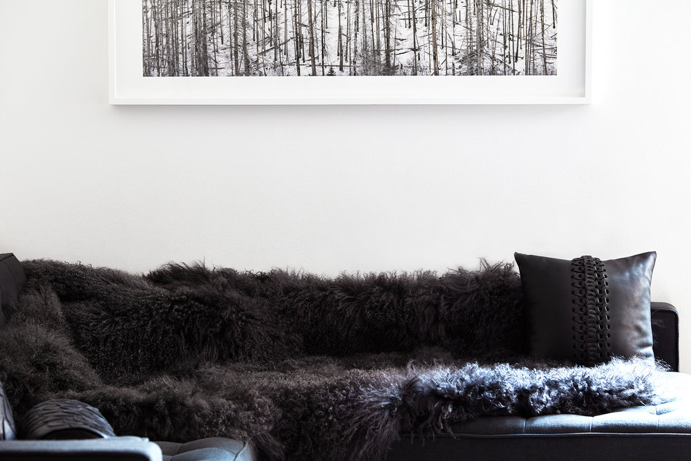 Shearling Throw Tibetan Lamb Hide Couch Cover Sheepskin Pillow Cushion Vertebrae Handcrafted Leather Bespoke Artwork David Nadel Montana Glacier National Park Couch Bobby Berk Home Gus Modern Bolster Mandala Emblem Minimalist Luxury Romantic Urban Apartment New York City Manhattan Loft Brooklyn Modern Design Interior Style
