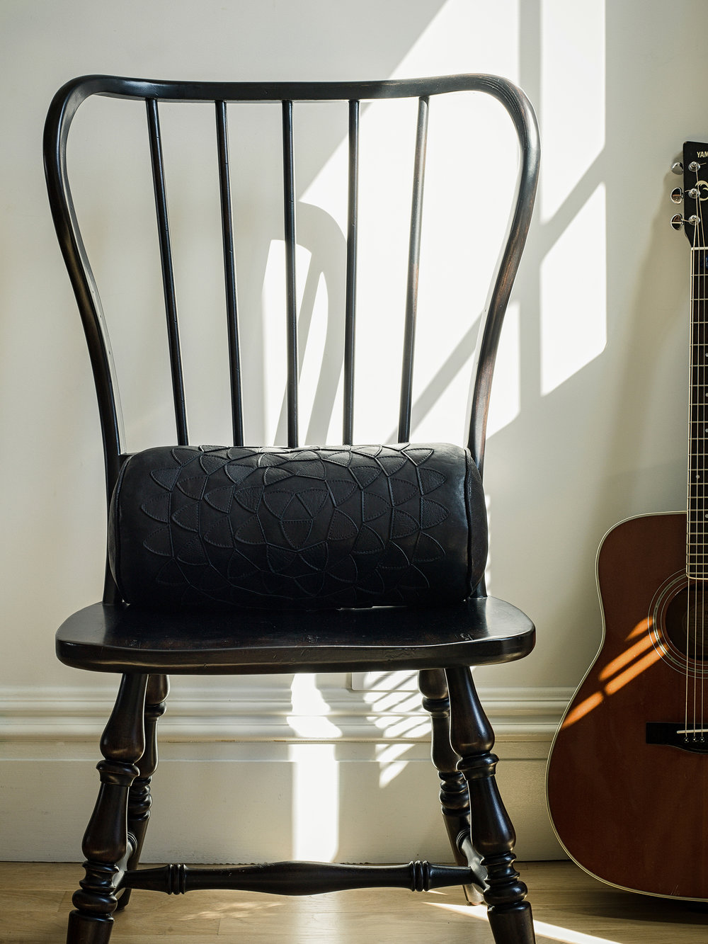 musician bachelor pad brooklyn park slope New York sacred geometry inspiration nicole watts styling interior design pillow decor fender guitar chair meditation mandala mindfulness lotus flower sunlight reflection Los Angeles Josephine Rozman jo living room home music inspired
