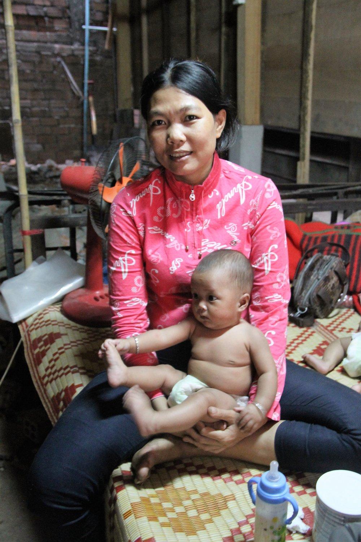Sim Srey Lin with one of her children