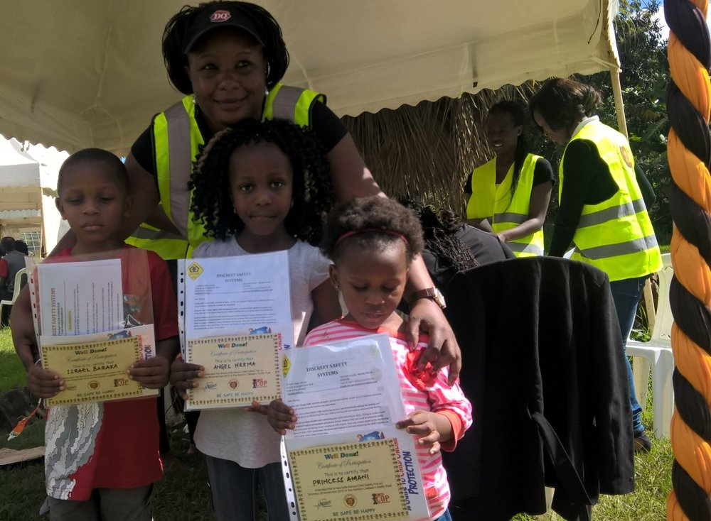 KIDS RECEIVE CERTIFICATES AFTER TRAINING.jpg
