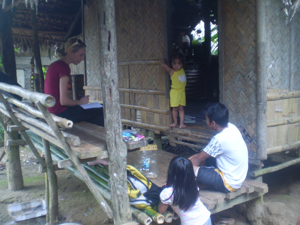 Christey interviewing survivor of labour trafficking,  Northern Samar,  Philippines