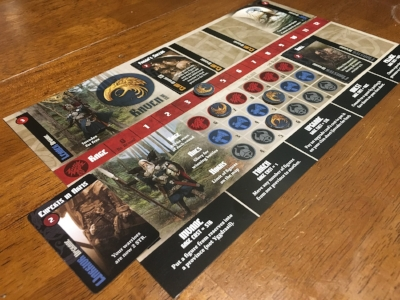 A player's faction board is slotted with various upgrade cards drafted each round.