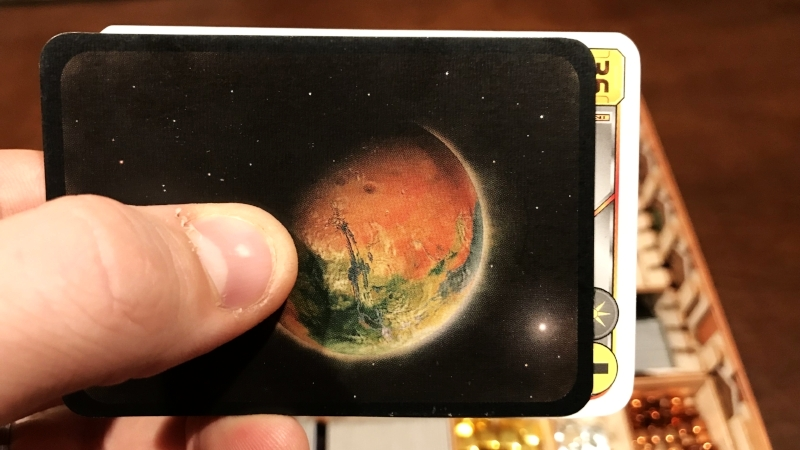 Side by side of a standard TM card (back) and a Venus Next card affected by the issue (front)