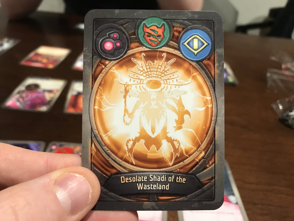 Every Keyforge deck has a unique back with the procedurally generated deck name. For what it's worth, Shadi's a 10.