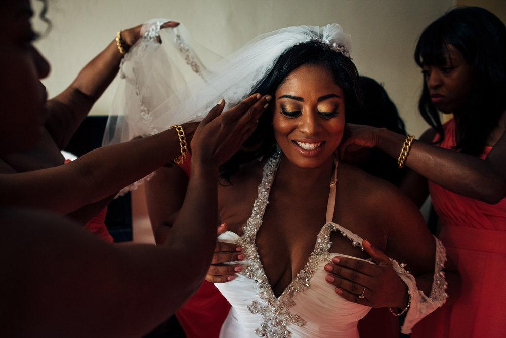 bride getting dress