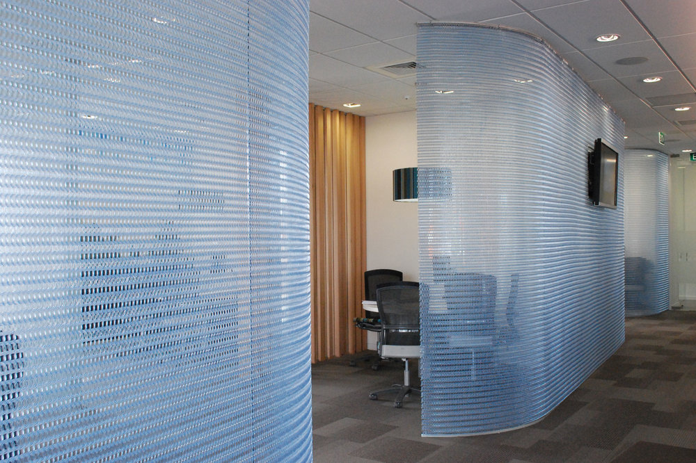 ANZ Hanging Screens sit over glass for protection and privacy